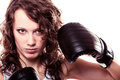 Sport boxer woman in black gloves fitness girl training kick boxing martial arts or emancipation idea concept showing her power Royalty Free Stock Photo