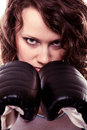 Sport boxer woman in black gloves fitness girl training kick boxing martial arts or emancipation idea concept showing her power Royalty Free Stock Images