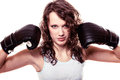 Sport boxer woman in black gloves fitness girl training kick boxing martial arts or emancipation idea concept showing her power Stock Photography