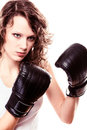 Sport boxer woman in black gloves fitness girl training kick boxing martial arts isolated on white studio shot Royalty Free Stock Image