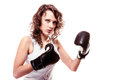 Sport boxer woman in black gloves fitness girl training kick boxing martial arts isolated on white studio shot Royalty Free Stock Photo