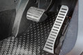 Sport car pedals interior shot of chrome with big gas pedal Royalty Free Stock Photos