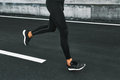 Sport. Close Up Of Male Legs Running On Road Outdoors. Royalty Free Stock Photo