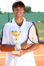 Sport competition successes tennis player with trophy Royalty Free Stock Photography