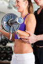 Sport - couple is exercising with barbell in gym Royalty Free Stock Images