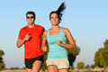 Sport couple running fitness in country road cheerful runners training outdoors on summer for and healthy lifestyle Royalty Free Stock Image