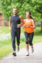 Sport couple running in park Stock Image