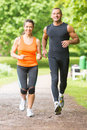 Sport couple running in park Stock Photos