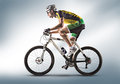 Sport cyclist riding a bicycle isolated against white background Royalty Free Stock Photos