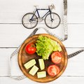 Sport and diet concept -  bicycle model, fresh vegetables and ce Royalty Free Stock Photo