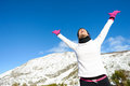 Sport and exercising winter success training on fitness happy successful woman raising arms after achieve running goals Stock Photo