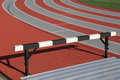Sport field track and athlete hurdling Royalty Free Stock Images