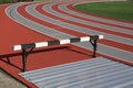 Sport field track and athlete hurdling Stock Image
