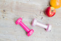 Sport fitness diet concept weights dumbbell and fruit Royalty Free Stock Photo