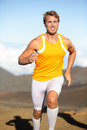 Sport fitness running man sprinting outside runner athlete exercising in beautiful nature outdoors fit muscular male model Royalty Free Stock Photo