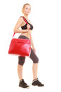 Sport fitness sporty girl in sportswear with gym bag and active lifestyle full length of red isolated on white Stock Photo