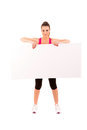 Sport fitness woman hold blank board advertisement with empty copy space young healthy smile girl athletic muscle body perfect Royalty Free Stock Photo