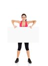 Sport fitness woman hold blank board advertisement empty copy space young healthy smile girl isolated over white background Royalty Free Stock Photo