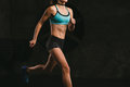 Sport fitness woman training on dark background. Beautiful body Royalty Free Stock Photo