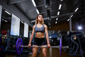 Sport girl with a barbell in her arms in the gym Royalty Free Stock Photo