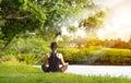 Sport Girl Meditating In Natur...