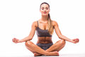 Sport girl relax in yoga pose after training Royalty Free Stock Photo