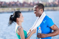 Sport is life young interracial couple relaxing after the outdo outdoot training Stock Image