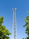 Sport light pole with blue sky background Stock Photos