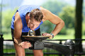 Sport man drinking water from public park fountain young male active adult thirsty after run or workout using the Royalty Free Stock Photo