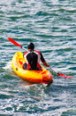 Sport man in kayak training active person having fun vacation sportsman sea water Stock Images