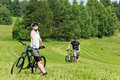 Sport mountain biking couple relax in meadows Stock Photos