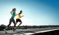 Sport people running outdoor asian couple doing exercise Stock Image