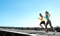 Sport people running outdoor asian couple doing exercise Royalty Free Stock Photography