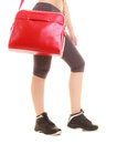 Sport red gym bag of fitness sporty girl in sportswear and active lifestyle isolated on white Stock Photography