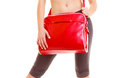 Sport red gym bag of sporty fitness girl isolated and active lifestyle closeup young woman in sportswear on white Stock Image