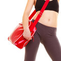 Sport red gym bag of sporty fitness girl isolated and active lifestyle closeup young woman in sportswear on white Royalty Free Stock Photography