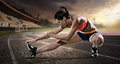Sport. Runner stretching on the running track. Royalty Free Stock Photo