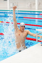 Sport swimmer winning. Man swimming cheering celebrating victory success smiling happy in pool wearing swim goggles and