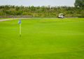 Sport view landscape sand bunker and green grass pattern of golf cart blue flag course at thailand Royalty Free Stock Photo
