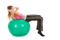 Sport woman with ball training the abs isolated over white background Stock Photos