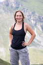 Sport woman in black t shirt standing on mountain nature background Royalty Free Stock Photos