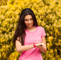 Sport woman checking her watch heart rate in pink Royalty Free Stock Image