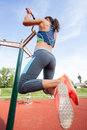 Sport woman doing pull ups outdoors sporty exercising outdoor on sunny day Royalty Free Stock Photos