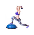 Sport woman exercise with a pilates ball and dumbbells exercising purple isolated on white background studio shot Royalty Free Stock Image