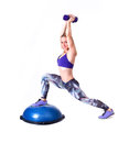 Sport woman exercise with a pilates ball and dumbbells exercising purple isolated on white background studio shot Royalty Free Stock Images