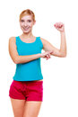 Sport woman fitness girl showing her muscles. Power and energy. Isolated. Royalty Free Stock Photo