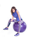 Sport woman with a pilates ball and dumbbells exercising purple isolated on white background studio shot Stock Images
