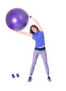 Sport woman with a pilates ball and dumbbells exercising purple isolated on white background studio shot Royalty Free Stock Images