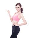 Sport woman is pointing out isolated on the white background asian Royalty Free Stock Photography