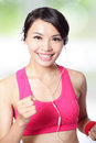 Sport woman running and listen music Royalty Free Stock Photo